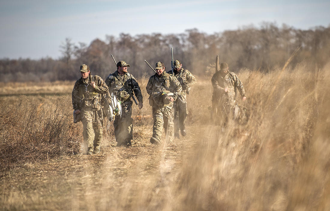 You won't shoot many ducks or geese if they can see you. And becoming invisible gets trickier with big groups. Photo © Bill Konway