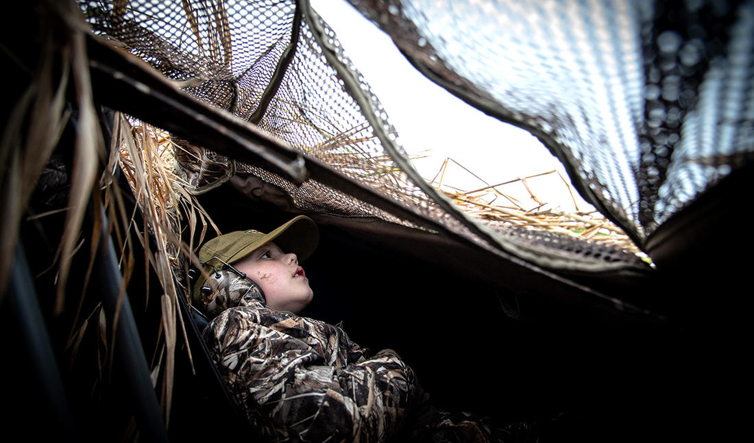 Experienced hunters often take the sights and smells of the marsh for granted. Not so with newcomers. Photo © Mike Reed