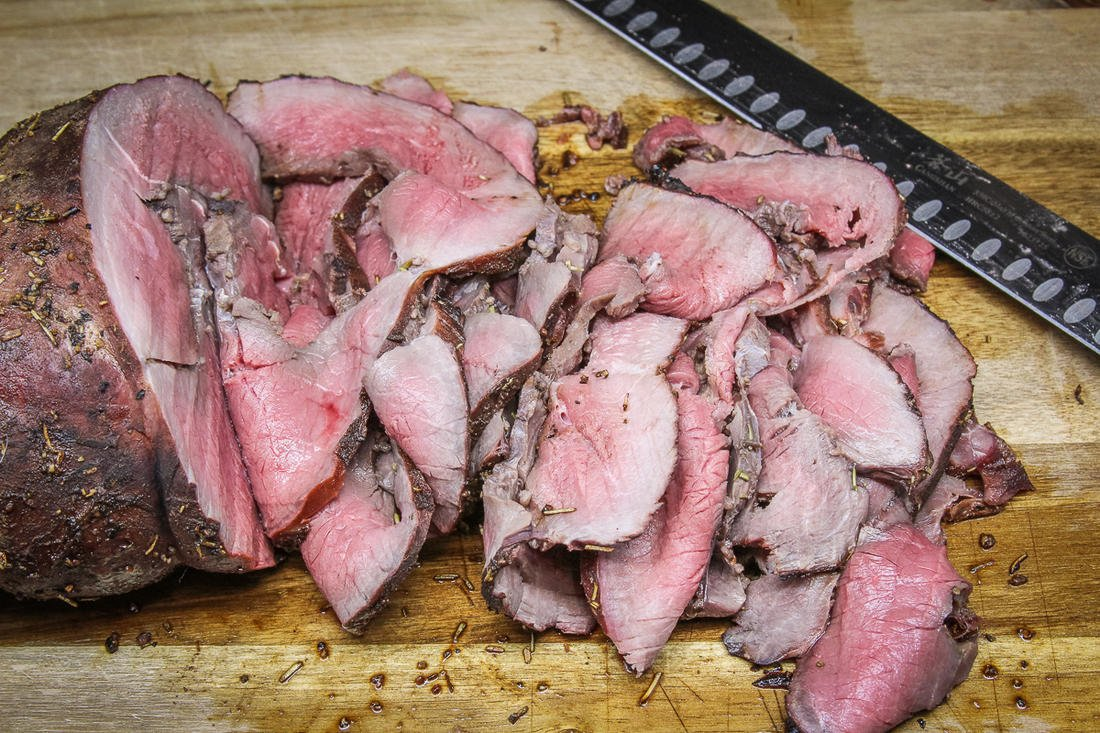Allow the roast to rest, then slice it thinly.