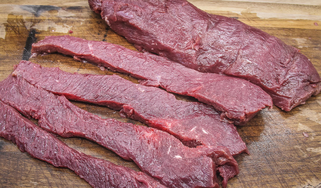 Slice the backstrap into long, thin strips.