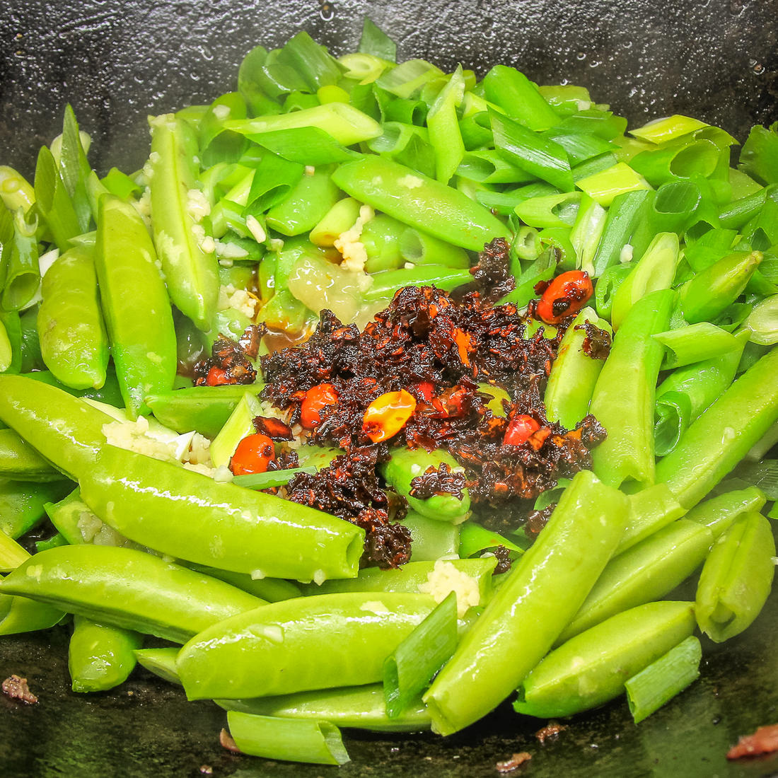 Add the snap peas and the chili flakes.