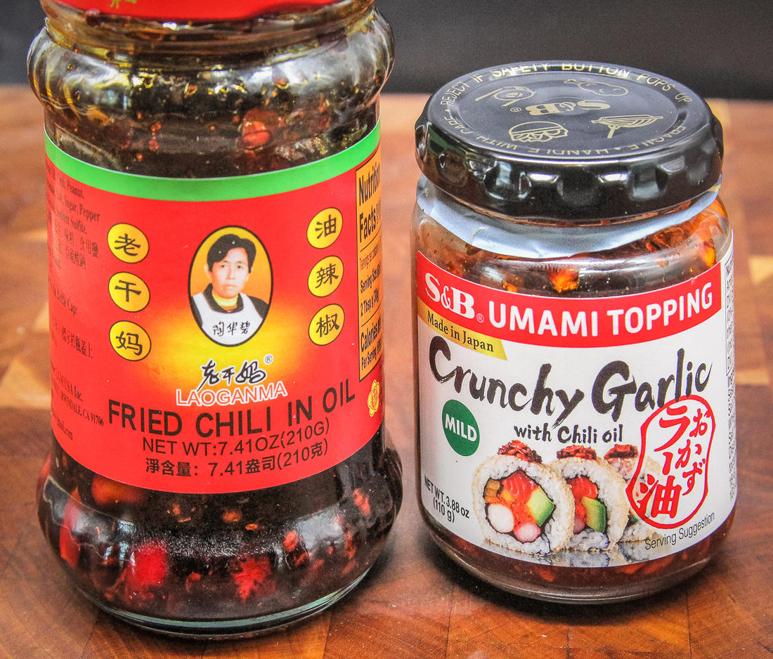 Chili flakes in oil and crispy garlic flakes are available at most Asian groceries or in large supermarkets.