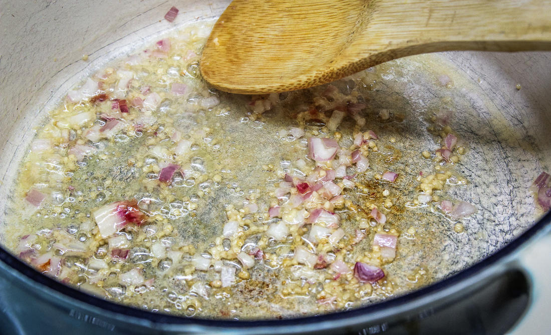 Sauté the shallots and garlic to start the sauce.