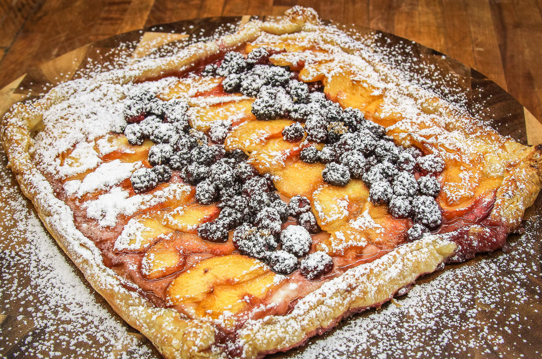 Dust the tart with powdered sugar before serving.