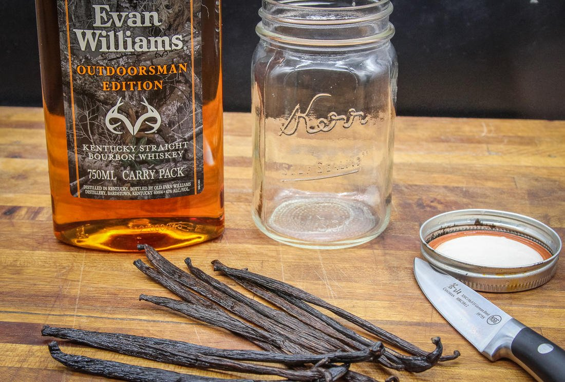 Soak vanilla beans in Evan Williams Bourbon to make your own vanilla extract for baking.