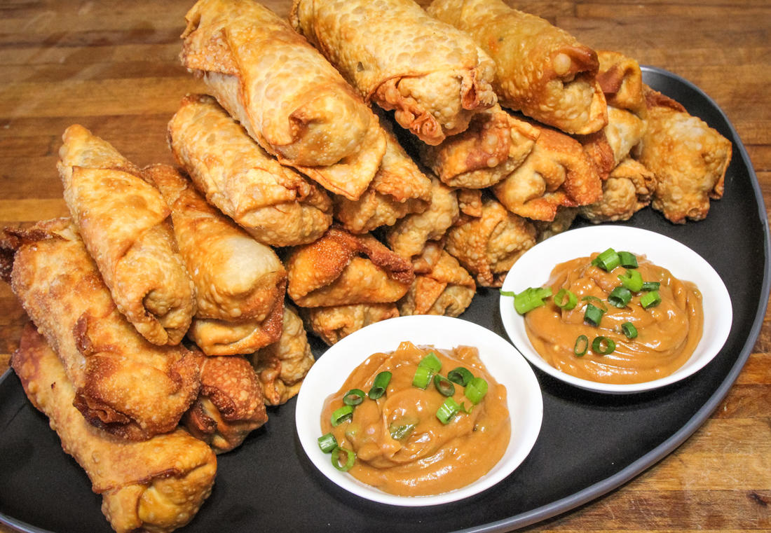 Serve the egg rolls with spicy peanut sesame dipping sauce.