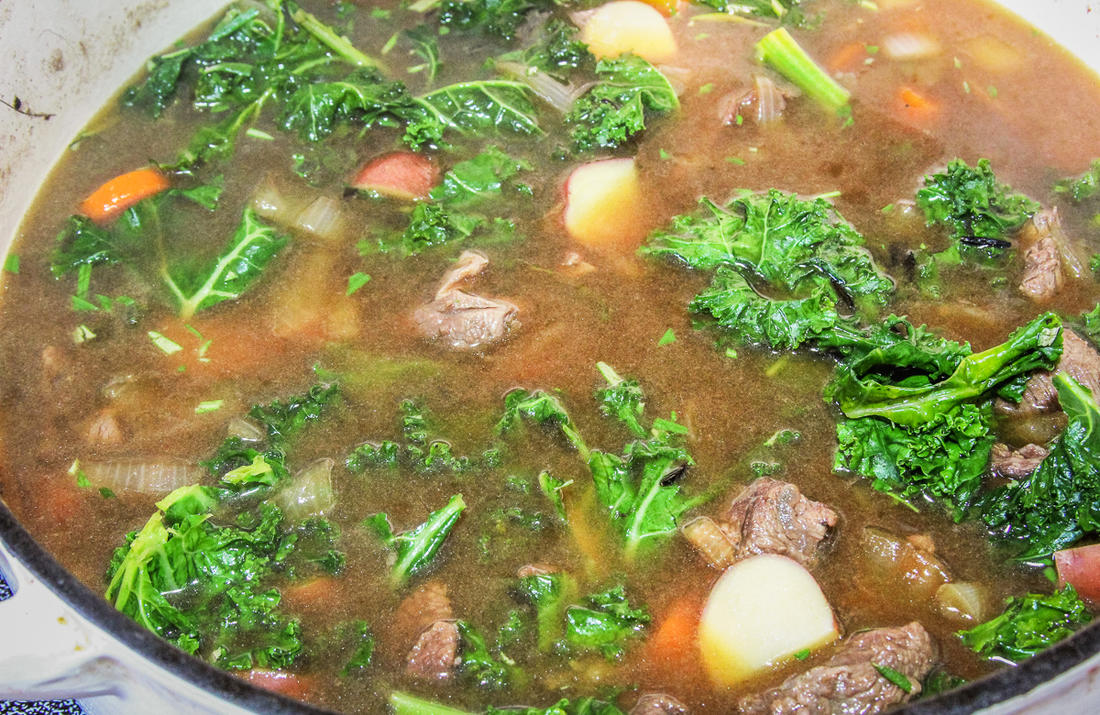 Simmer the meat for an hour, then add the wild rice, potatoes, kale and remaining ingredients.