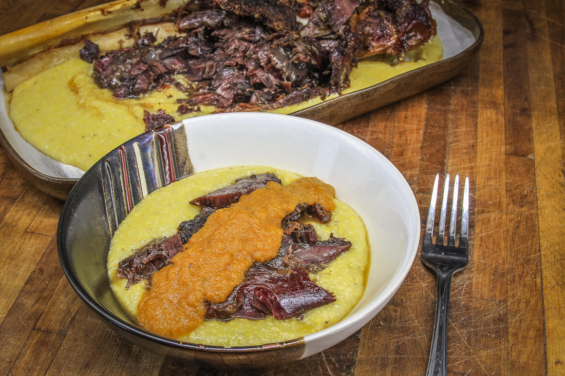 Serve the shanks over grits and topped with a spoonful of the blended vegetable sauce.