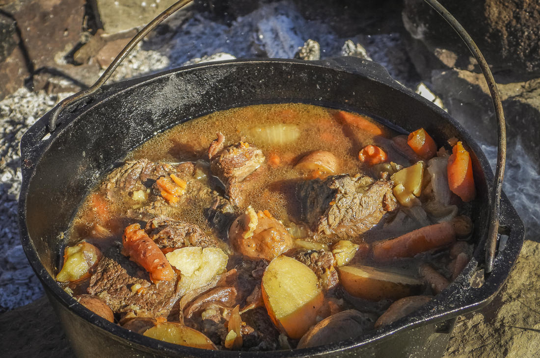 Slowly simmer the roast until the meat and vegetables are tender.