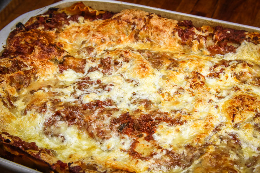 Top with a layer of sauce and plenty of cheese, then bake to a golden brown.