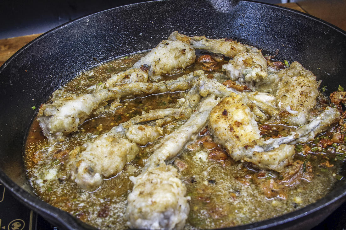Return the fried legs to the pan after reducing the sauce to thicken.