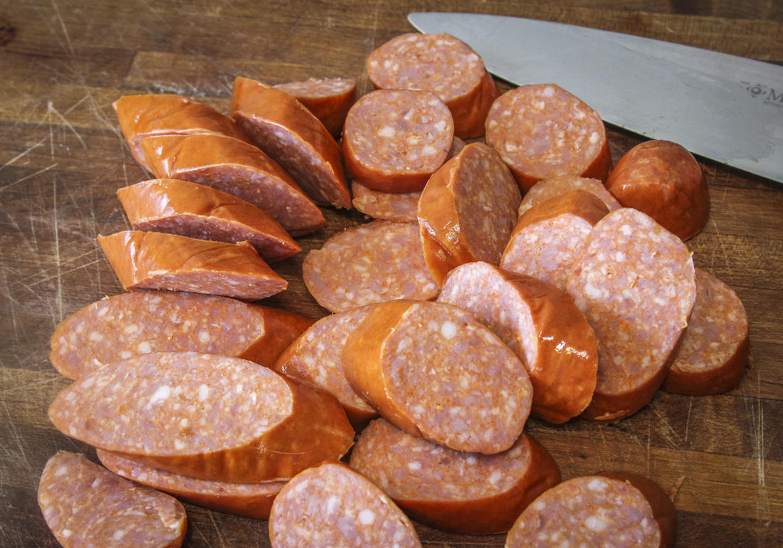 Slice up a pound of your favorite smoked sausage or andouille.