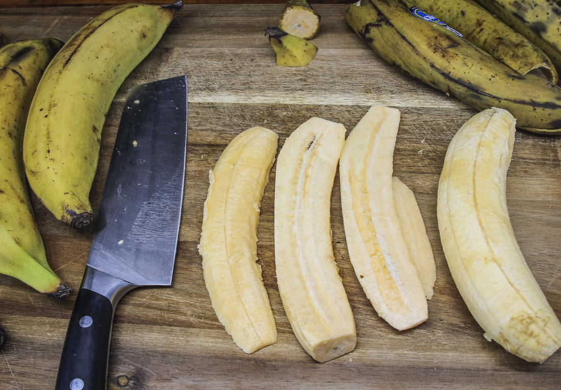 Peel the plantains and slice into thin strips.