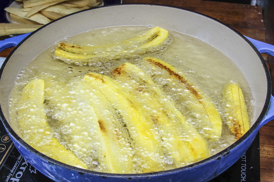 Fry the plantain strips before adding them to the dish.