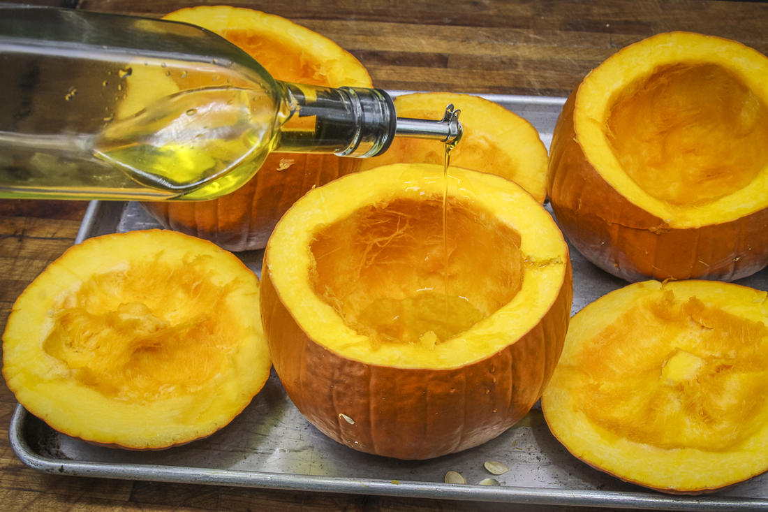 Hollow out the pumpkin shells and drizzle with olive oil before roasting.
