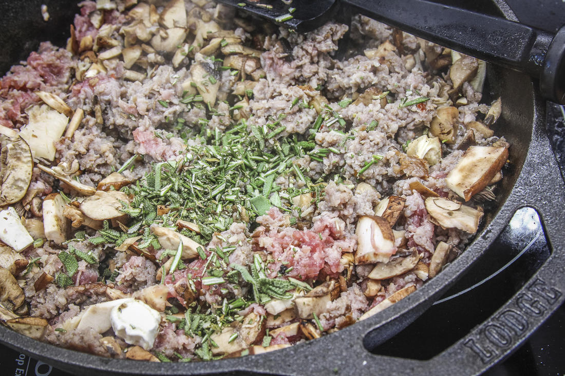 Brown the sausage and add the mushrooms and herbs for the stuffing.