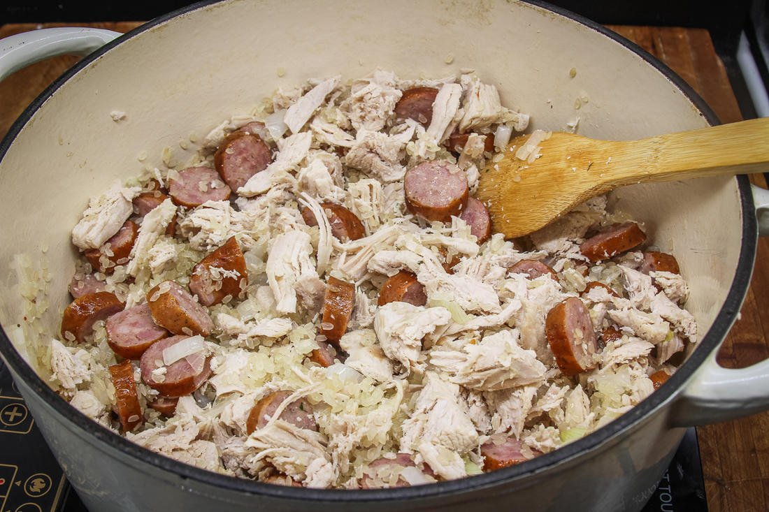 Brown the sausage with more onion before adding the shredded turkey and rice.