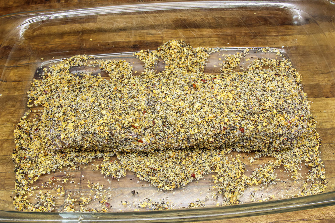 Roll the backstrap in Montreal steak seasoning to form the crust.