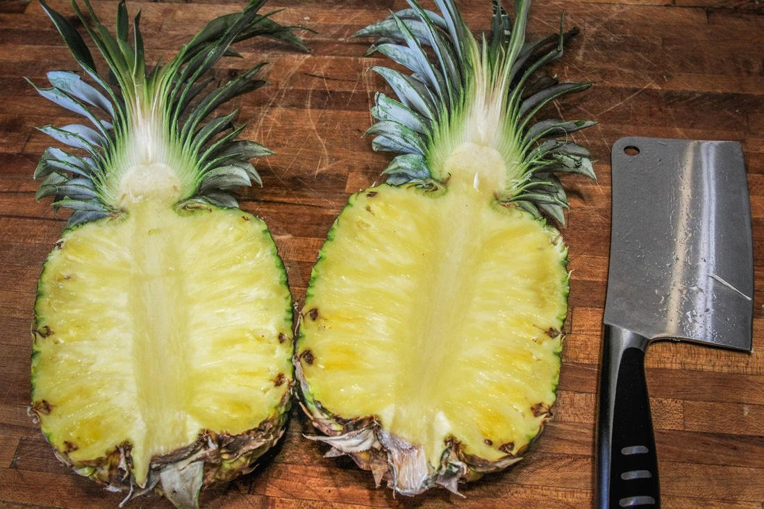 If using a whole pineapple, cut it in half vertically.