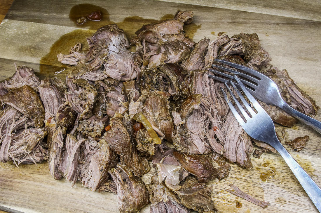 Use forks to shred the roast.