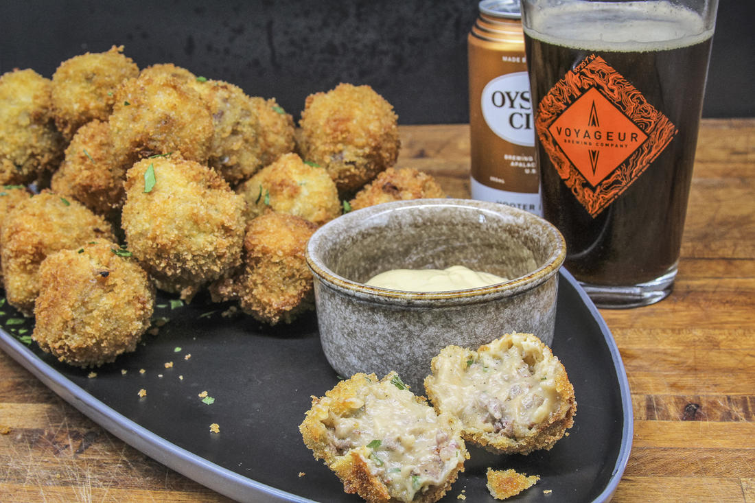 Serve the bitterballen with mustard for dipping and your favorite beer.
