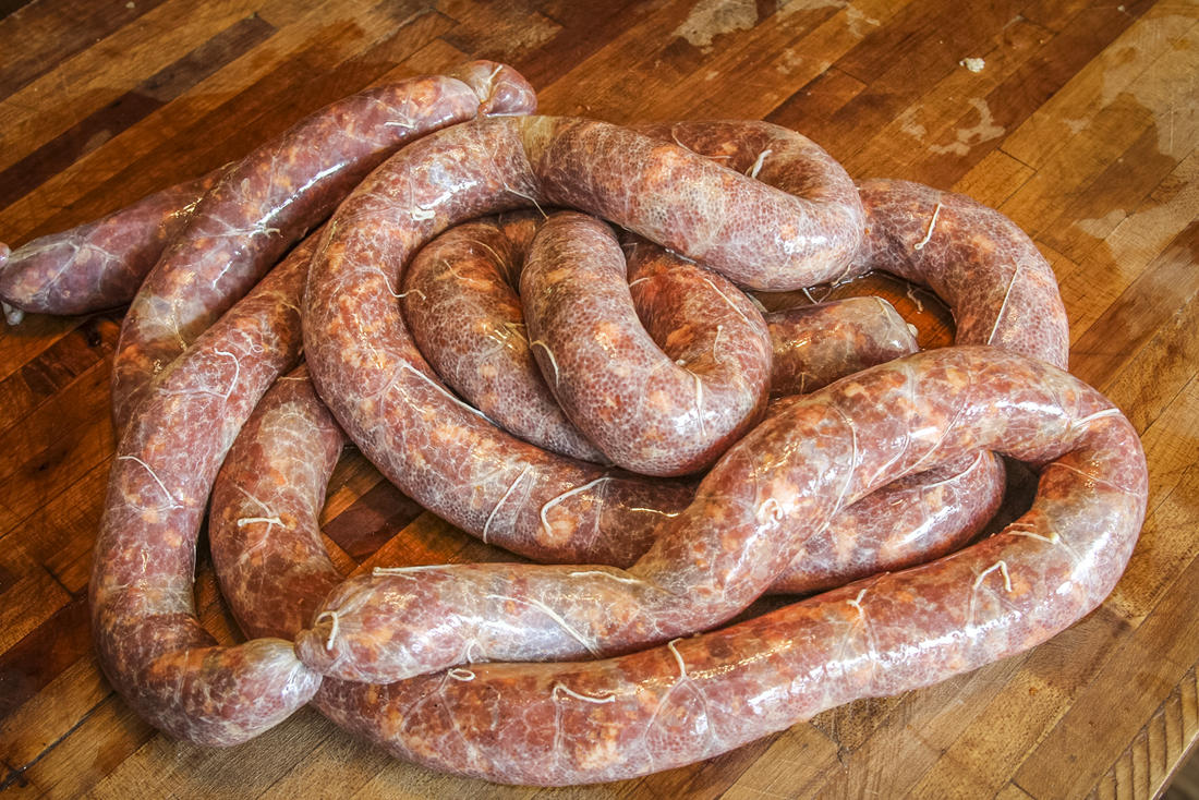 Grind up some game meat to make sausages for the grill.