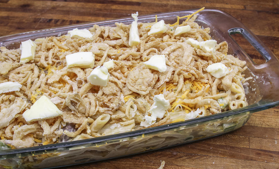 Top the mac 'n' cheese with fried onions and dot with butter before baking.