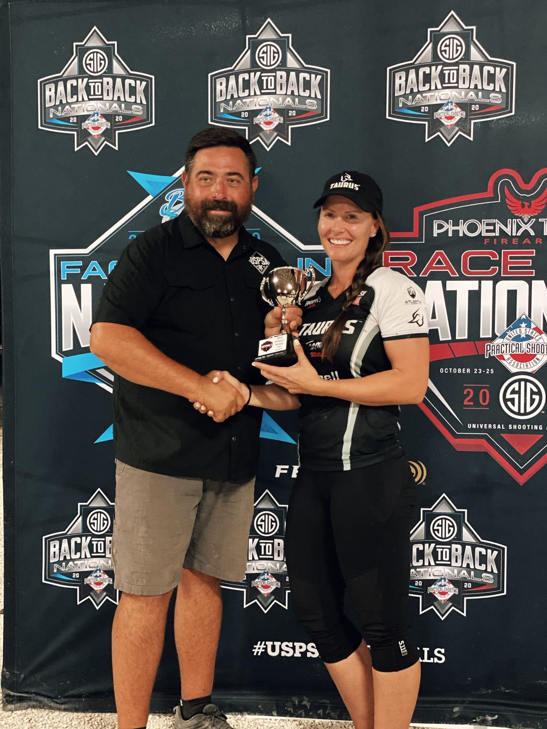 President of USPSA, Mike Foley, congratulates Jessie Harrison for her win at the 2020 Race Gun Nationals.