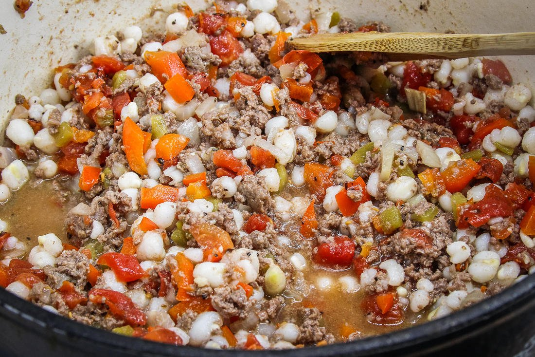 After browning, add the hominy and other ingredients.