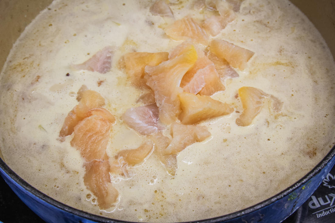 Add the fish and cream, then continue to simmer.