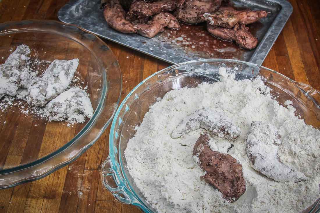Roll the cooked squirrel in seasoned flour before frying.
