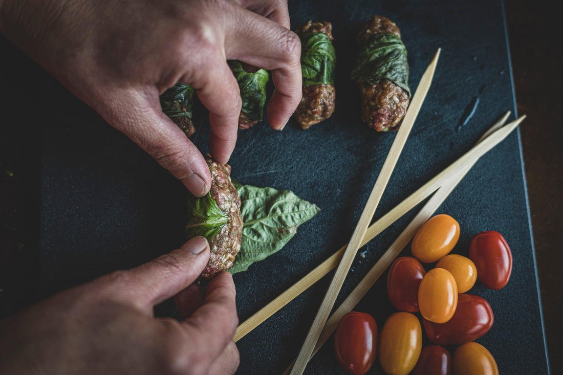 Roll the meat mixture in a mint or basil leaf. Image by Grit Media
