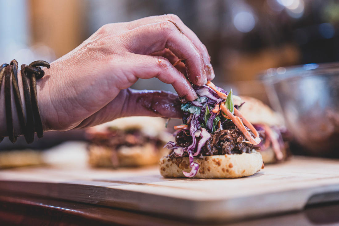 Assemble the sliders. Don't worry about things getting a little messy, but keep the napkins handy. Image by Grit Media
