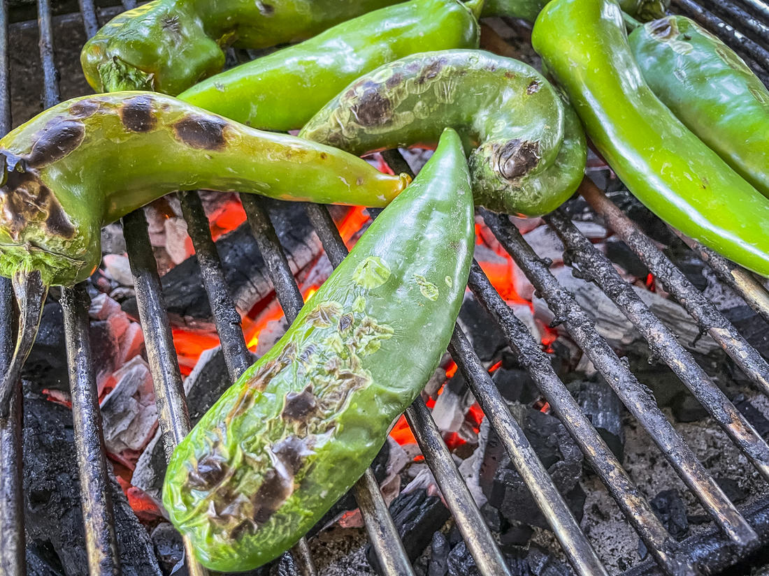 Roast the Hatch chiles or other fresh green chile peppers to add flavor and make skin removal easy.