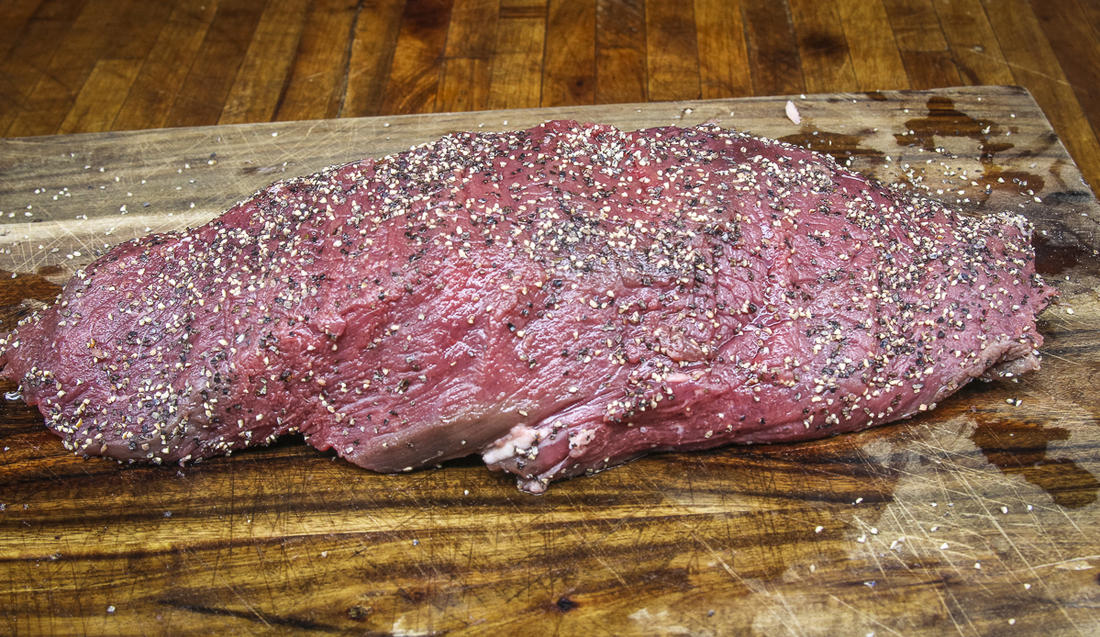 Season the backstrap well with black pepper.