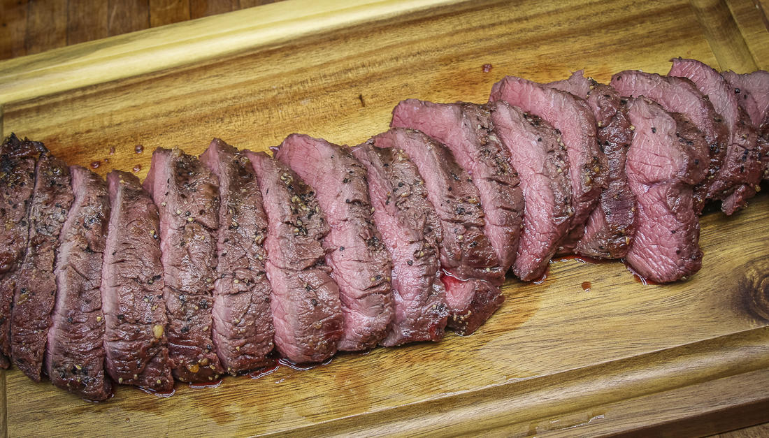 Grill the backstrap to medium-rare and slice against the grain for tenderness.