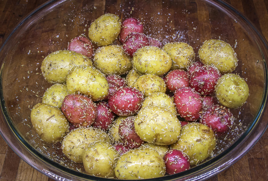 Toss the potatoes with olive oil, then season well with salt and rosemary.