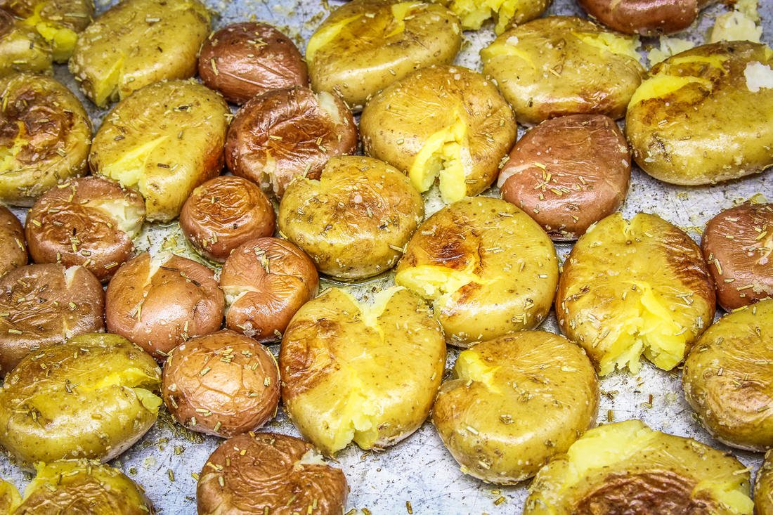 Roast the potatoes until softened, smash with a fork, then return to the oven.