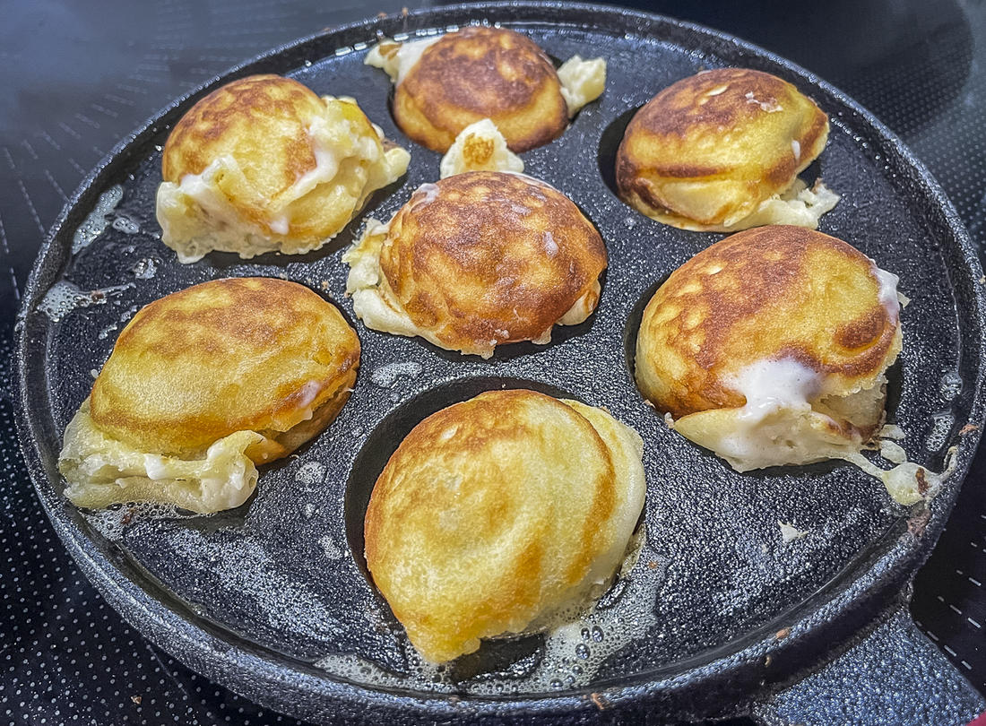 The aebleskivers will puff up as they cook.