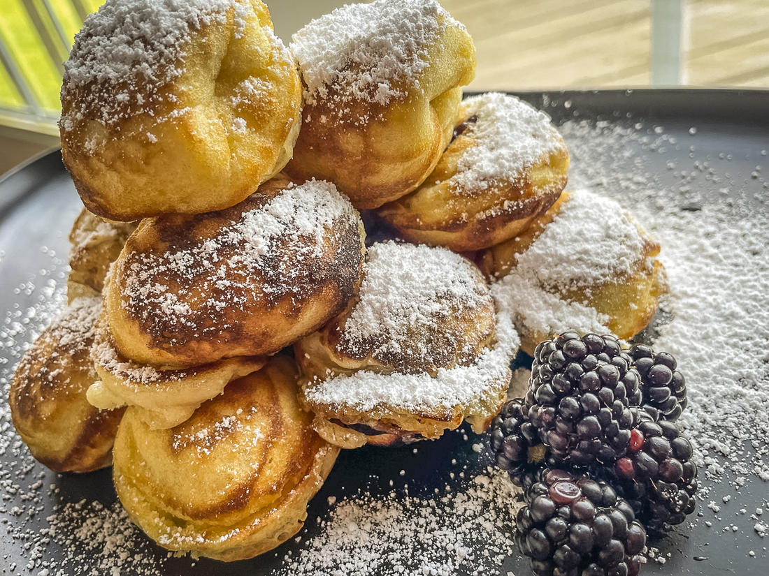 Top the aebleskivers with powdered sugar, honey, or maple syrup.