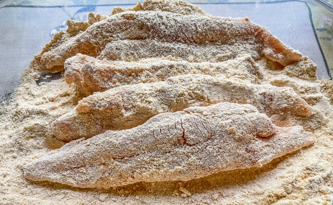 Roll the fillets in your favorite cornmeal-based breading mixture.
