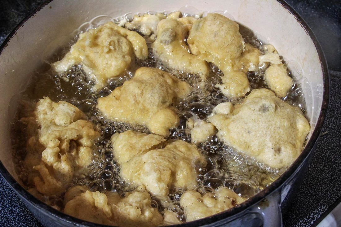 Drop the fritter dough into hot oil a few at a time and cook until golden brown.