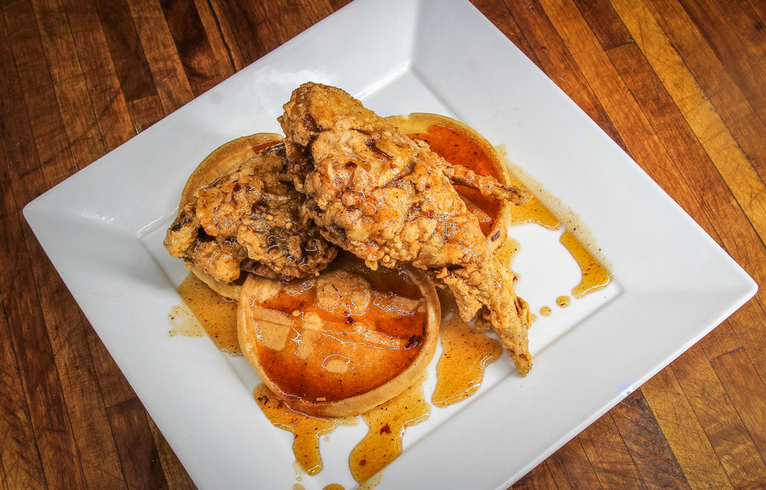 Stack the fried rabbit over waffles and drizzle the Cajun honey over the top.