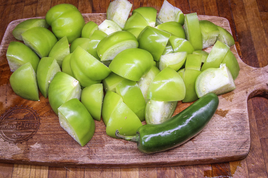 Quarter the tomatillos and dice the jalapeno.
