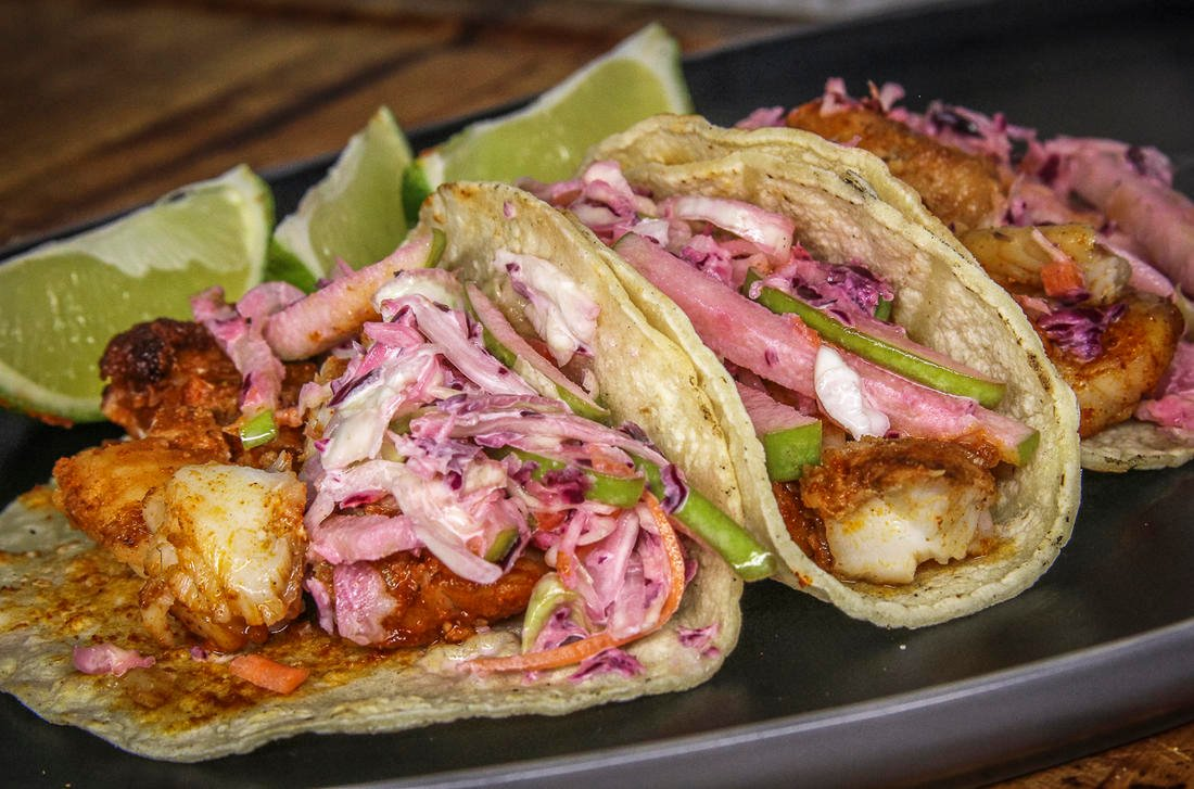 Spicy blackened fish is the perfect pairing for this sweet and tart apple and cabbage slaw.