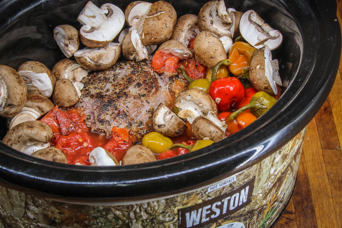 Load the roast and other ingredients into the slow cooker.
