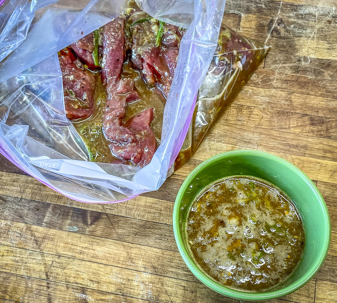 Pour part of the marinade over the meat and reserve the rest for a cooking sauce.