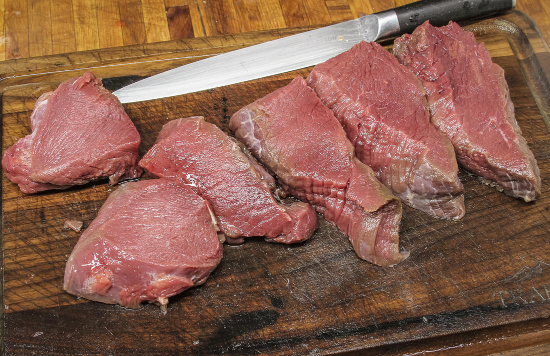Slice your elk or other wild game steaks to your desired thickness and grill once the bacon jam is ready to eat.