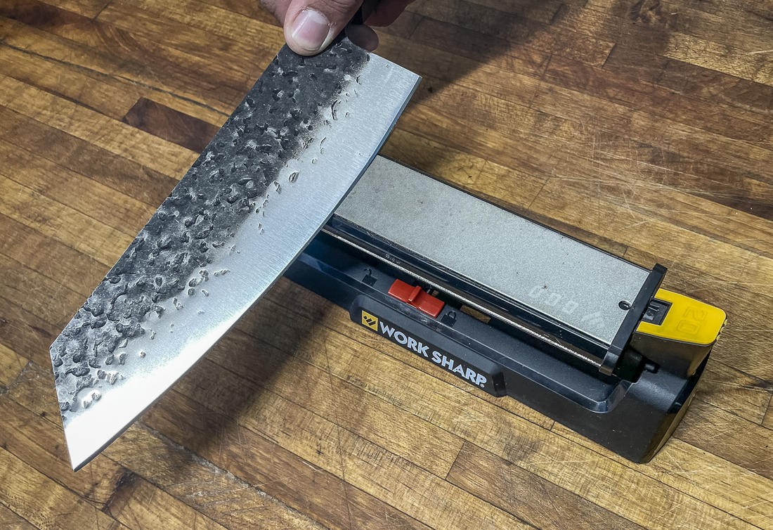 Sharpening stones can be natural, like an Arkansas stone, or synthetic, like this 600 grit diamond surface.