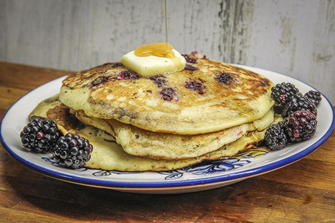 Adding fresh blackberries to fluffy buttermilk pancakes takes the flavor to a whole new level.